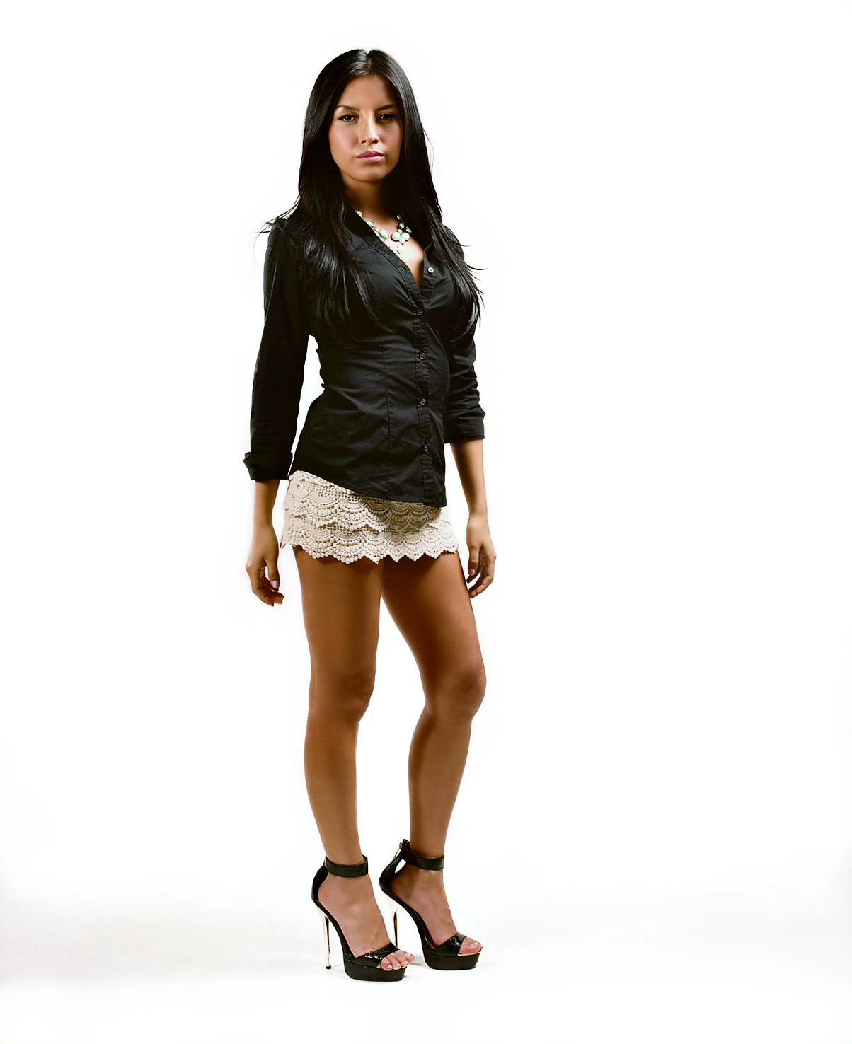 Full body studio portrait of Lissette with her arms at her waist