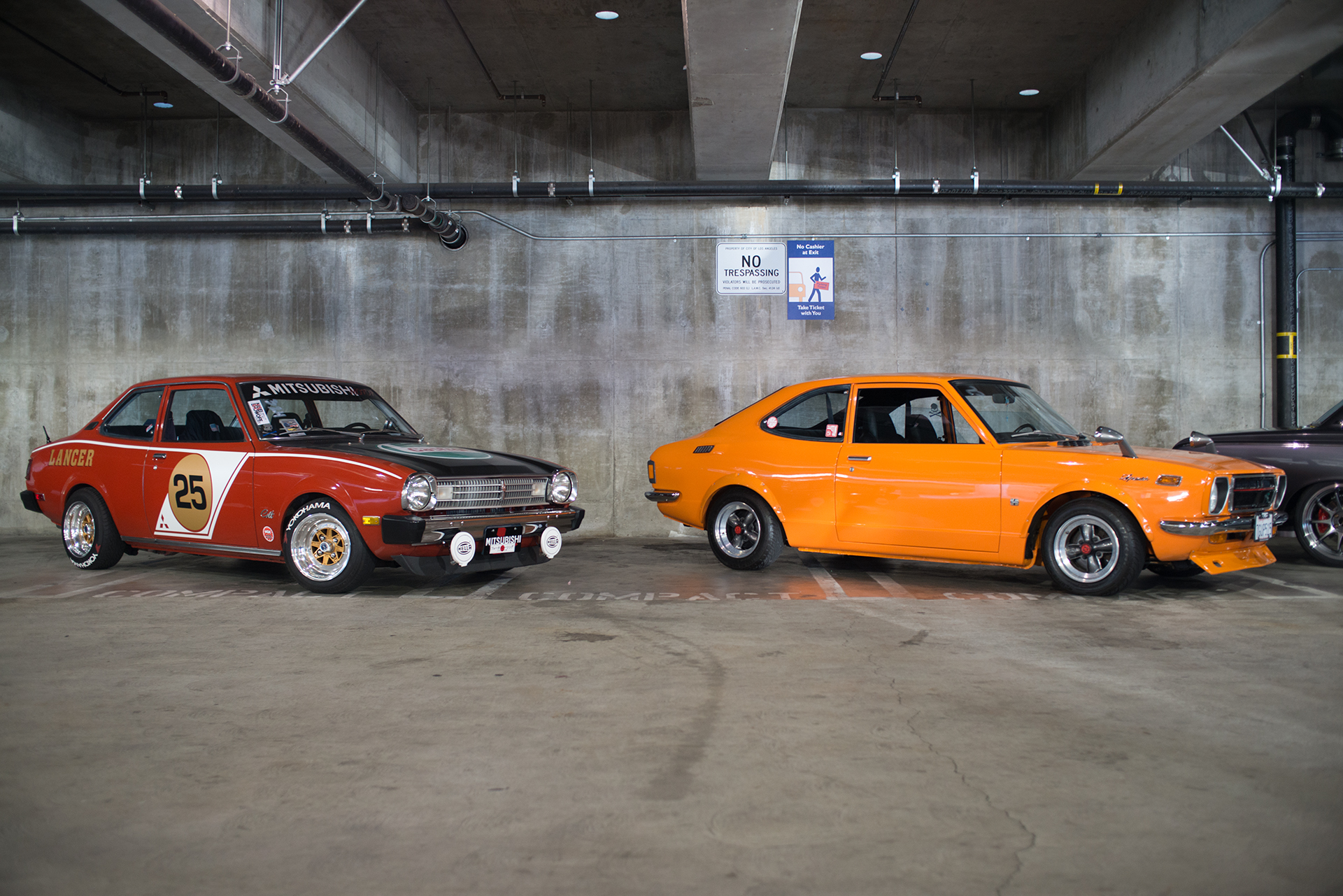 Classic Mitsubishi Lancer and Datsun something at Show Off Cafe 2017