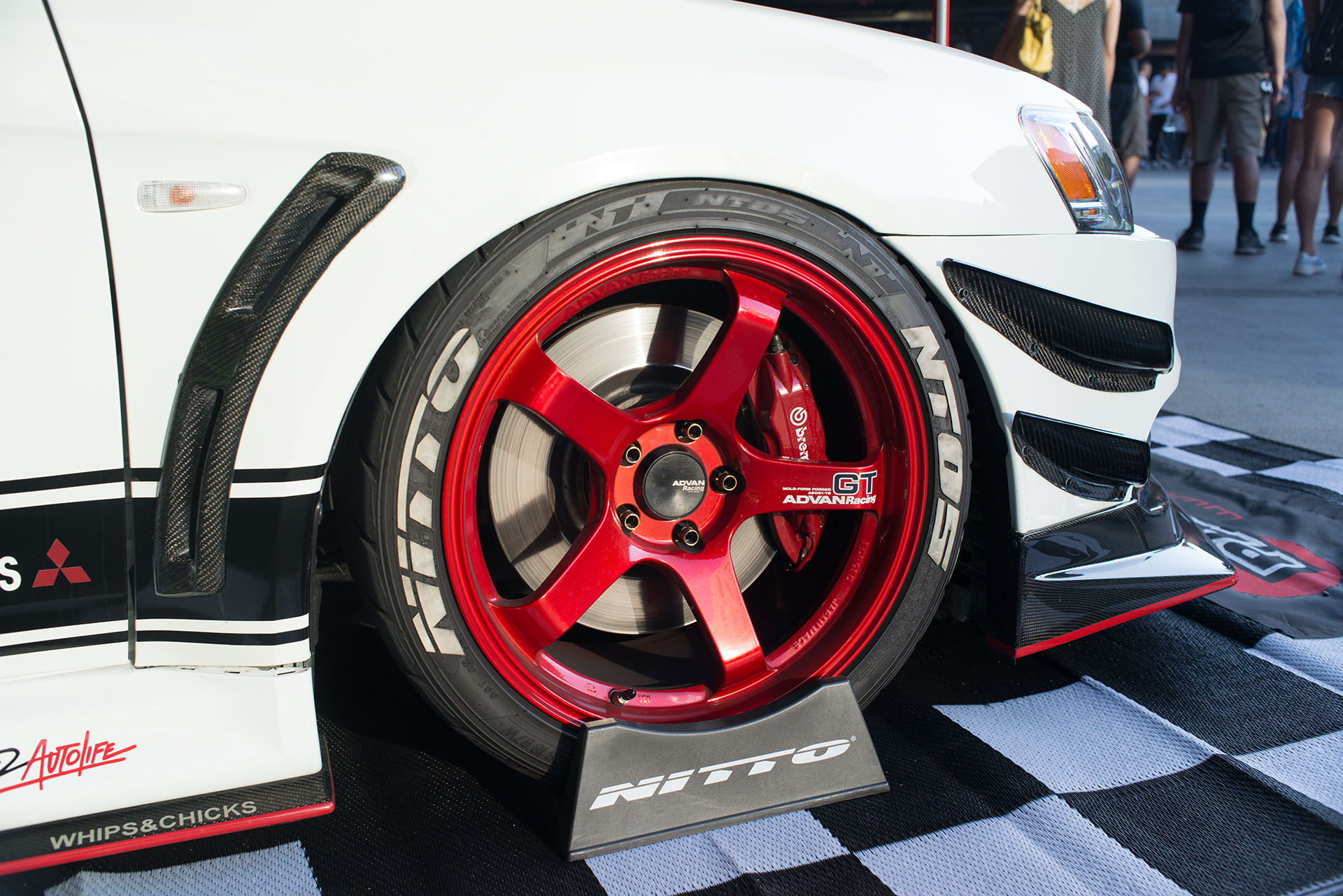 Red Advan GT wheels on an Evo X at Show Off Cafe 2017