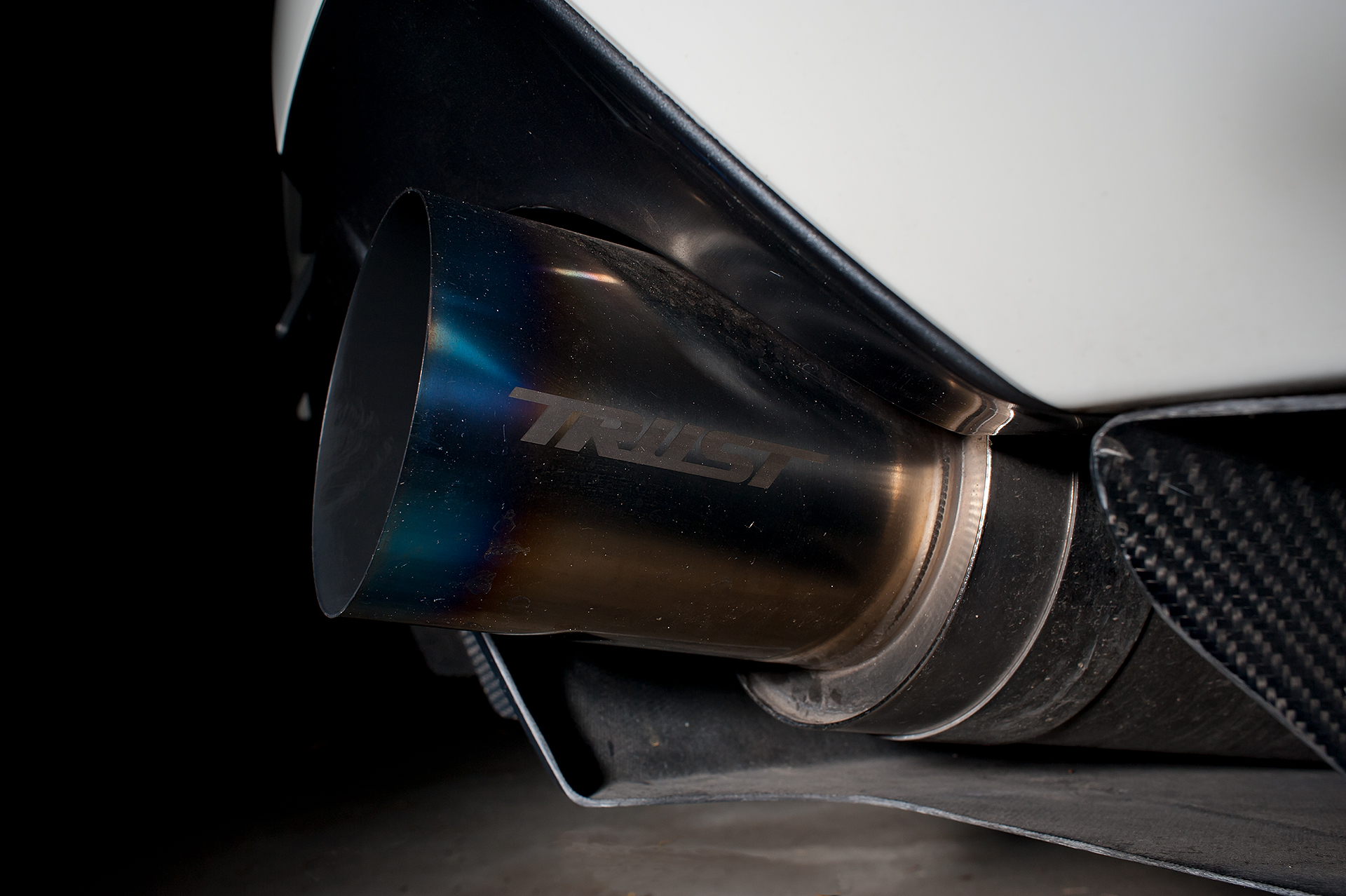 Exhaust shot of White Mitsubishi Evo IX with Varis body kit