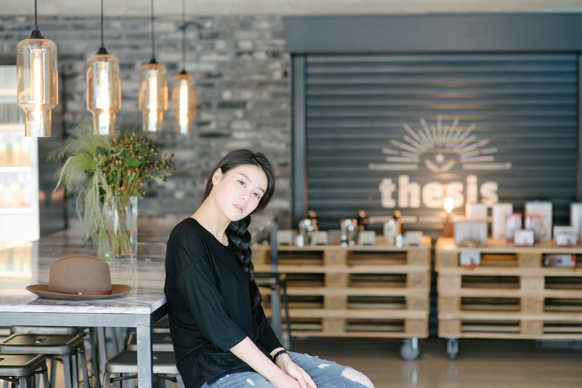 Korean model Jinhee Heo sitting in Thesis coffee shop