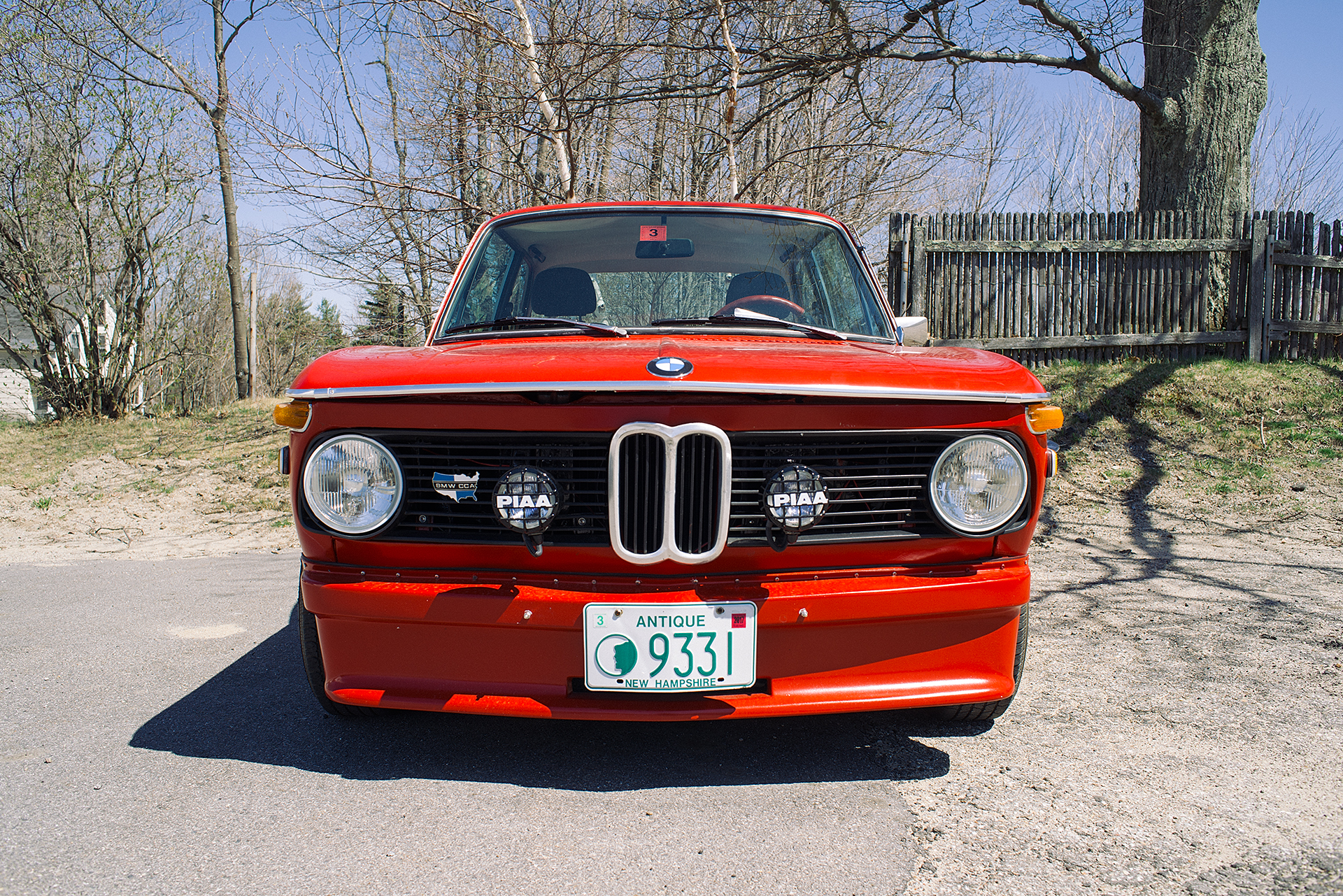Front shot of a restored Red BMW 2002