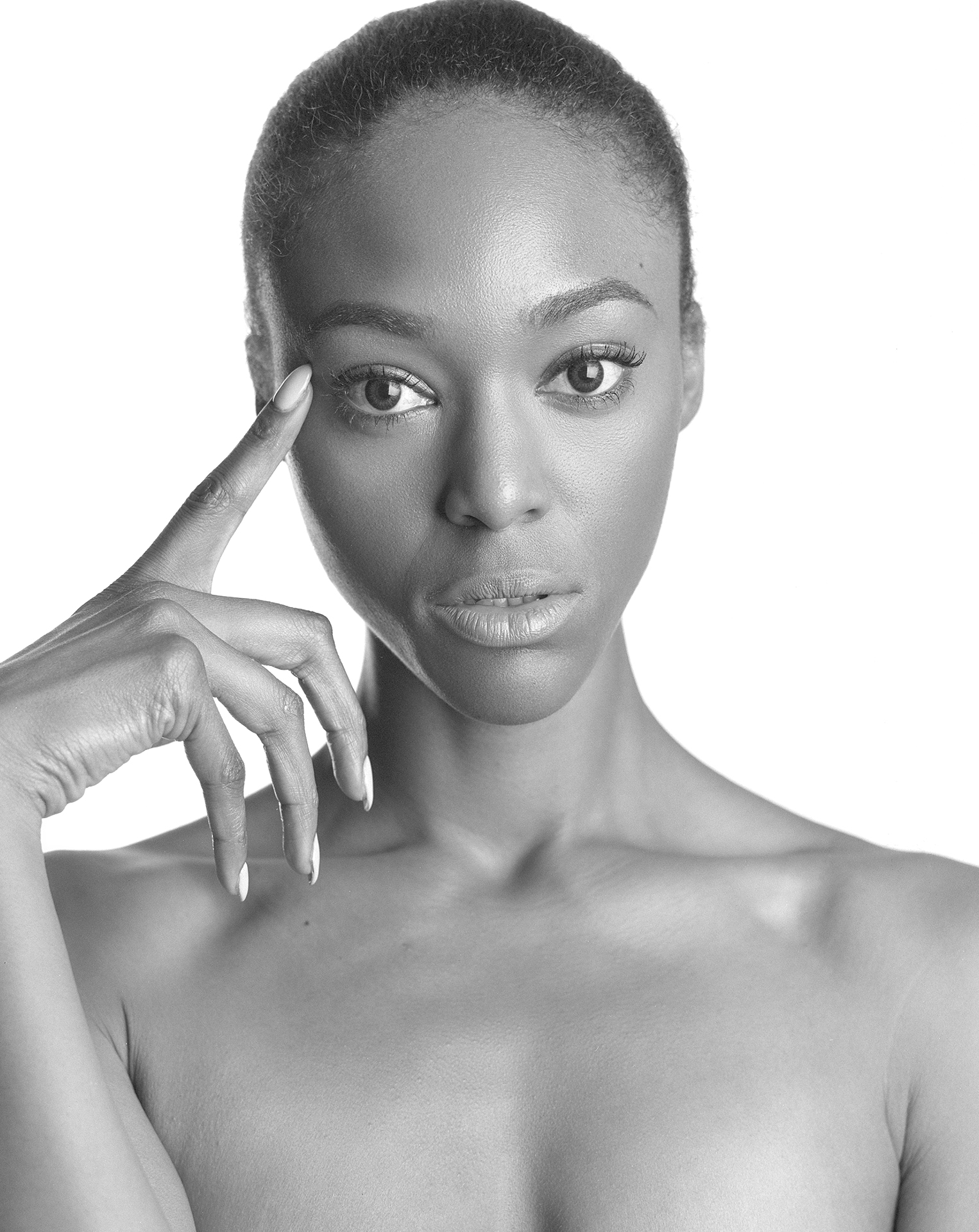 Black & white chest up high key portrait of model Ty'Kea Trichelle