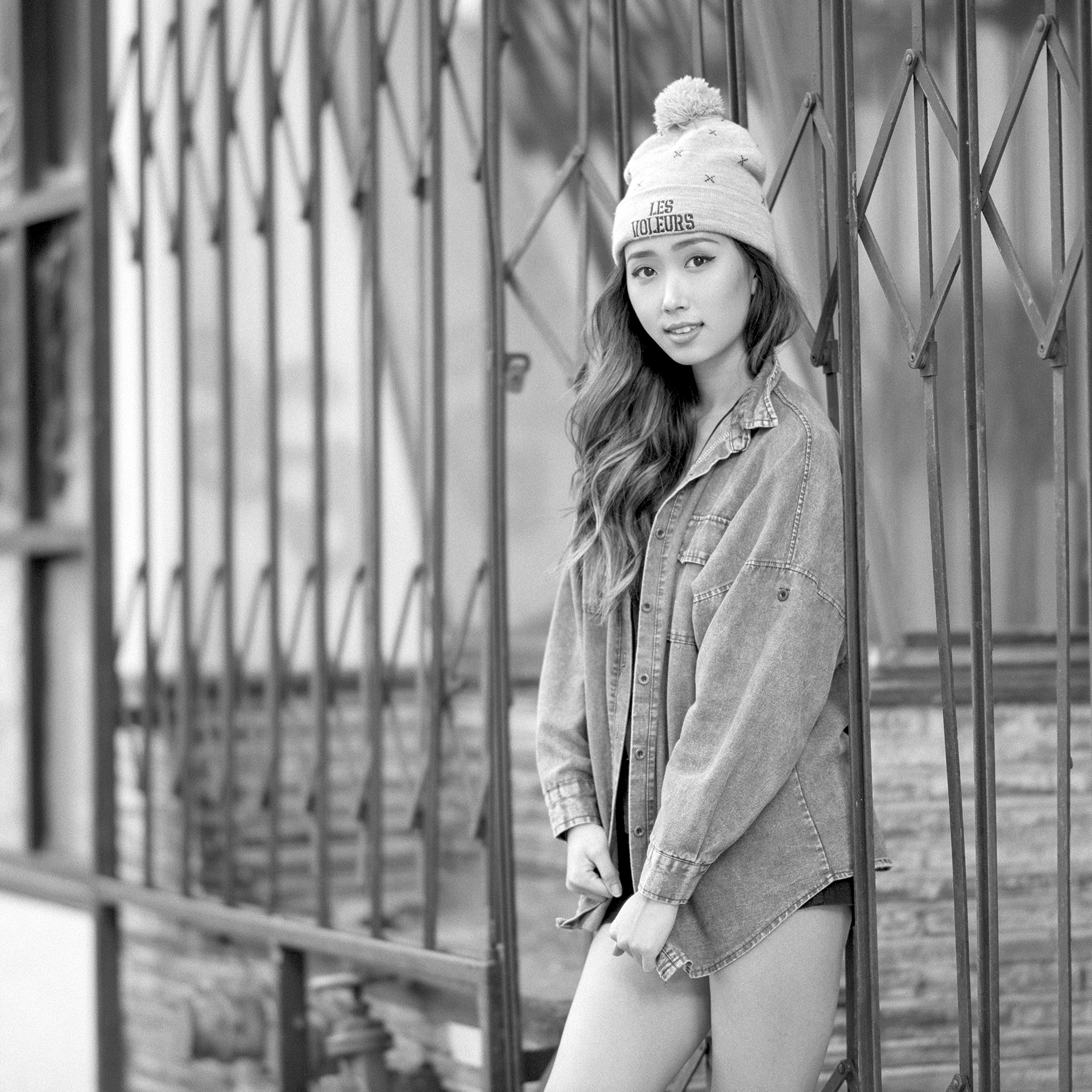 Black & white 3/4 length outdoor portrait of Korean American model Shawna Kim