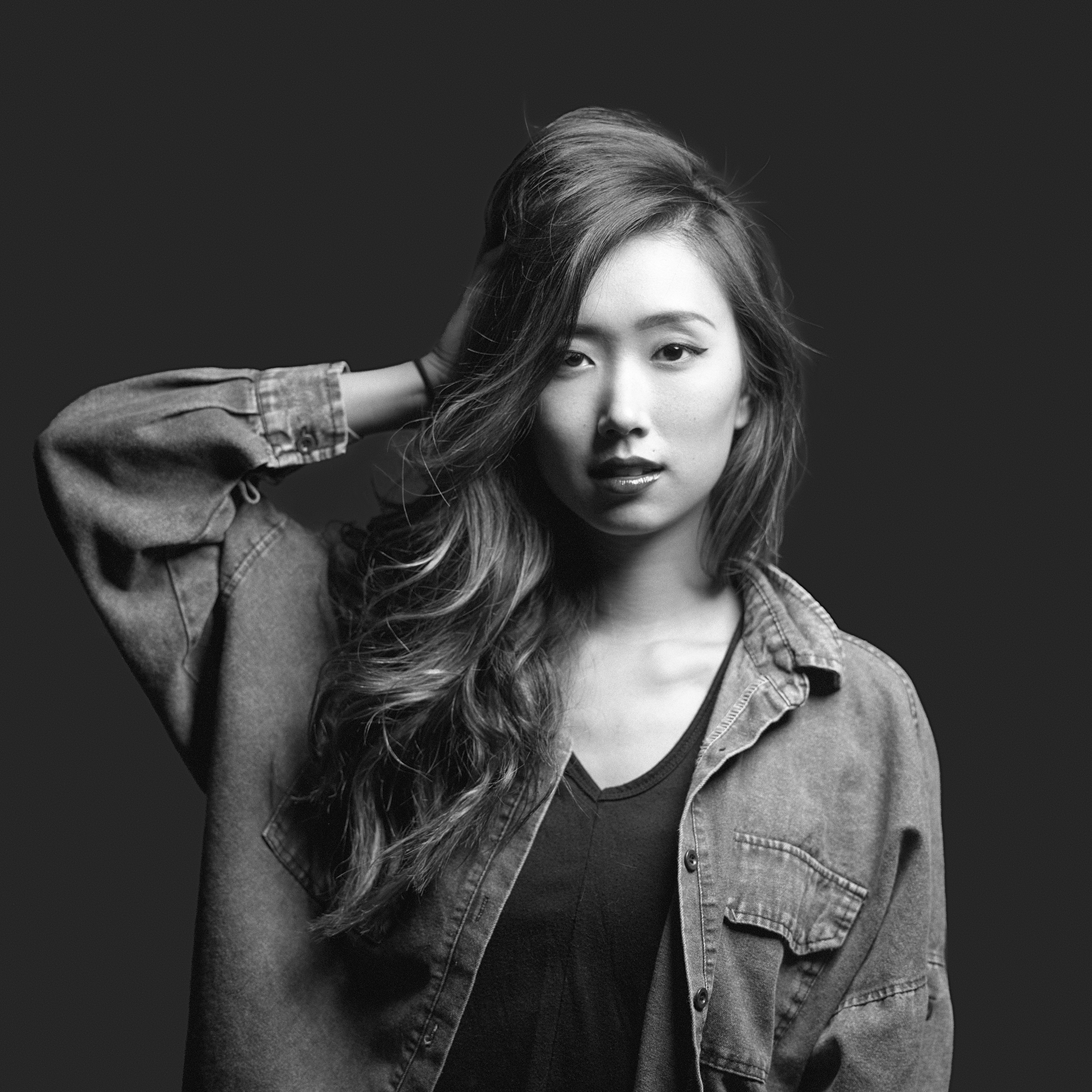 Black & white 1/2 body studio portrait of Korean American model Shawna Kim