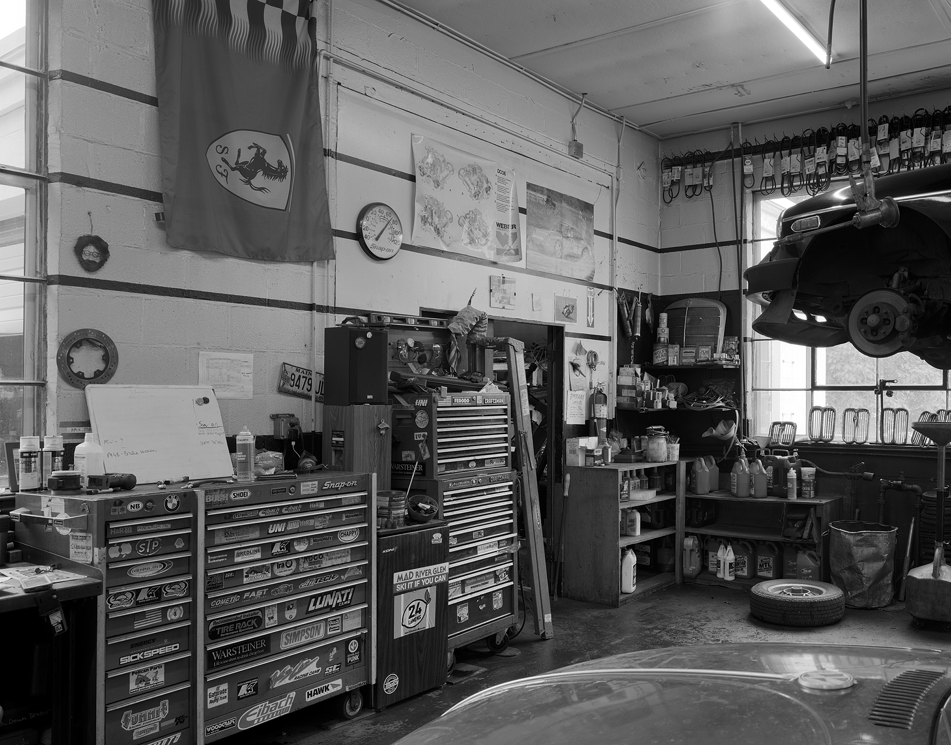 Black & white interior shot of AVA Restoration services' tool boxes