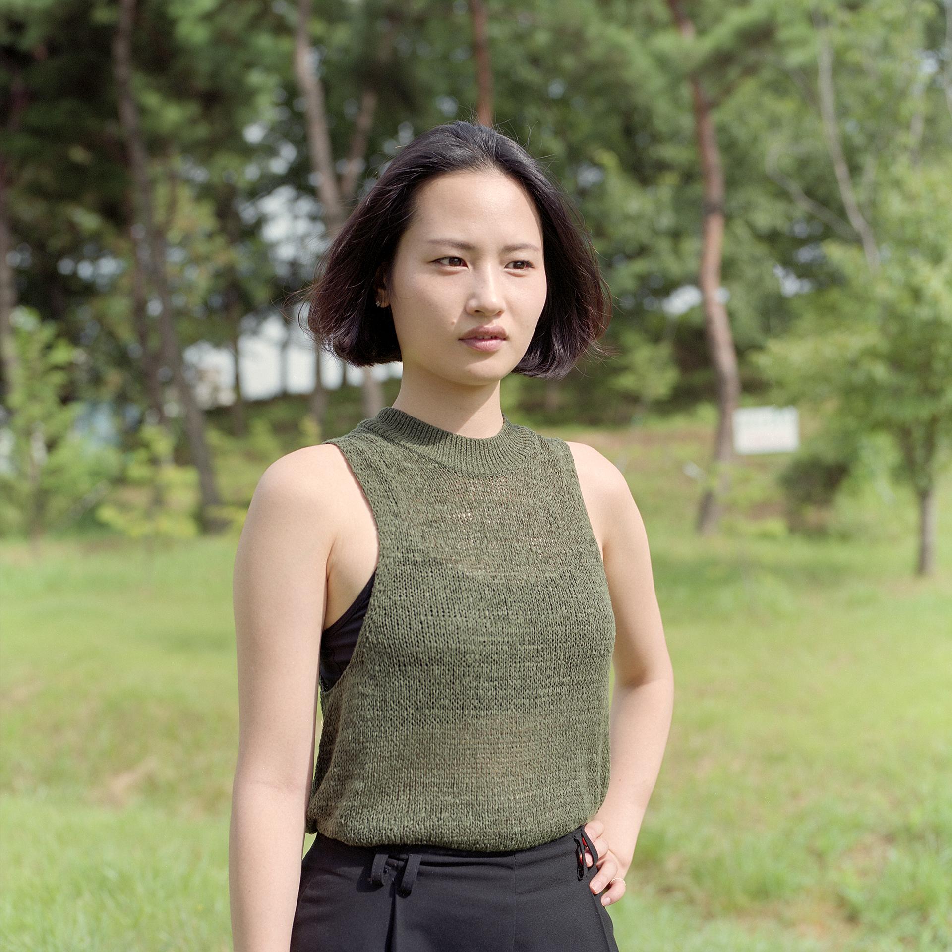 Waist up outdoor portrait of Korean model Shin Nal